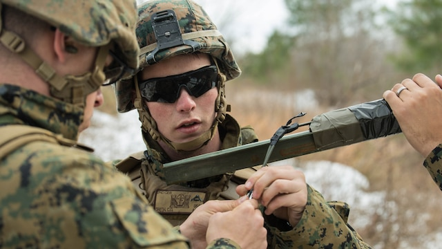 Lance Cpl. Colin Smith, a combat engineer with 2nd Combat Engineer Battalion, replaces blasting caps on an improvised Bangalore during a Deployment for Training exercise at Fort A.P. Hill, Va., Jan. 28, 2016. Marines utilized the larger ranges Fort A.P. Hill offers to gain a more realistic combat training experience before deploying to Okinawa, Japan.