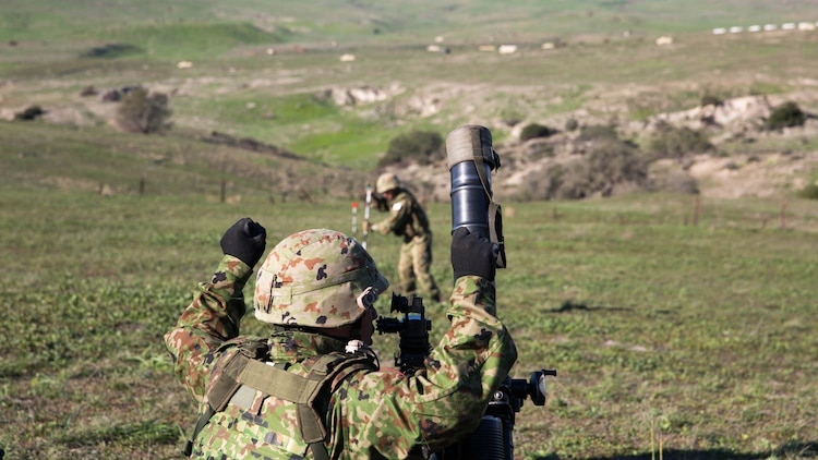 A Japan Ground Self-Defense Force mortar team adjusts their targeting stakes during a live-fire mortar range, during Exercise Iron Fist 2016, aboard Marine Corps Base Camp Pendleton, Calif., Feb 1, 2016. As a part of Exercise Iron Fist, this training was conducted to prepare the JGSDF soldiers for more advanced, bilateral combined arms training aboard Marine Corps Air-Ground Combat Center Twentynine Palms later in the month.