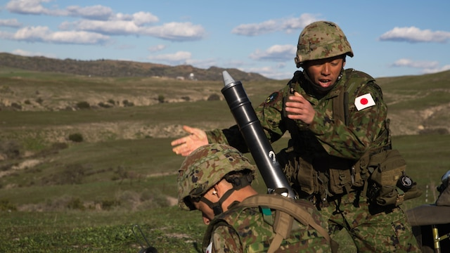 A Japan Ground Self-Defense Force mortarman drops a round down the tube of an 81mm mortar, during a live-fire training exercise, aboard Marine Corps Base Camp Pendleton, Calif., Feb 1, 2016. This mortar range is a part of the second phase of training the soldiers of the JGSDF and USMC will be conducting as a part of Exercise Iron Fist, which focuses on small unit skills and tactics before moving on to larger scale operations.