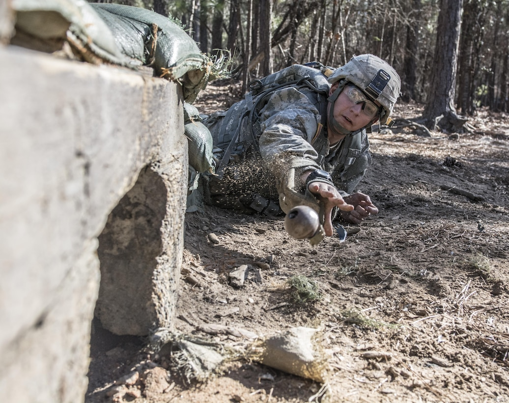 A Soldier in Basic Combat Training with C Company, 1st Battalion, 61st Infantry Regiment tosses a practice grenade into a bunker on the hand grenade assault course at Fort Jackson, S.C., Feb. 1, 2016. (U.S. Army photo by Sgt. 1st Class Brian Hamilton)
