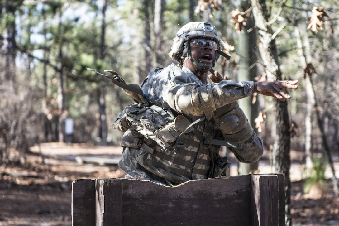 A Soldier in Basic Combat Training with C Company, 1st Battalion, 61st Infantry Regiment tosses a practice grenade from the standing position on the hand grenade assault course at Fort Jackson, S.C., Feb. 1, 2016. (U.S. Army photo by Sgt. 1st Class Brian Hamilton)