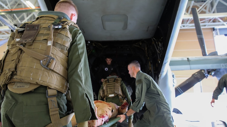 Petty Officer 2nd Class Mark Skaggs teaches Lance Cpl. Michael Jacobsen how to properly load casualties onto aircraft during a simulated casualty evacuation scenario at Marine Corps Base Camp Pendleton, Jan. 27, 2016. This training was part of the newly formed combat operation medical emergency transport training. COMETT exposes the aircrew to medical emergencies and procedures they may encounter in combat and non-combat environments. Jacobsen is an ordnance technician with Marine Aircraft Group 29.