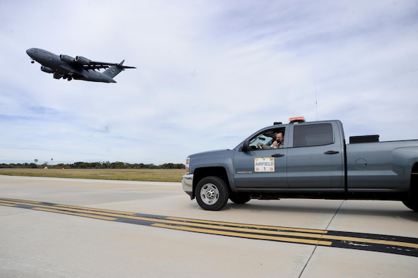 Staff Sgt. Michael David, an airfield management operations supervisor with the 6th Operations Support Squadron, waits for the air traffic control tower to clear him onto the airfield at MacDill Air Force Base, Fla., Jan. 22, 2016. Airfield management Airmen are responsible for performing multiple daily airfield checks to ensure it's safe for aircraft. (U.S. Air Force photo/Airman 1st Class Mariette M. Adams)
