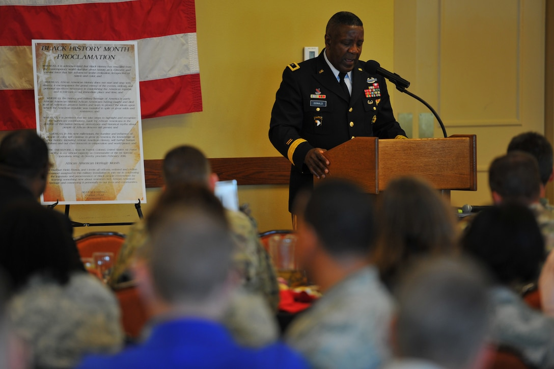 Retired U.S. Army Brig. Gen. James Donald speaks to more than 100 Air Commandos during Hurlburt Field's African American Heritage Month kick-off luncheon at The Soundside Catering on Hurlburt Field, Fla., Feb. 1, 2016. The Jackson, Miss., native and first African American Army ROTC graduate from the University of Mississippi served 33 years in the Army and served in numerous key command and staff assignments. (U.S. Air Force Photo by Airman 1st Class Joseph Pick)