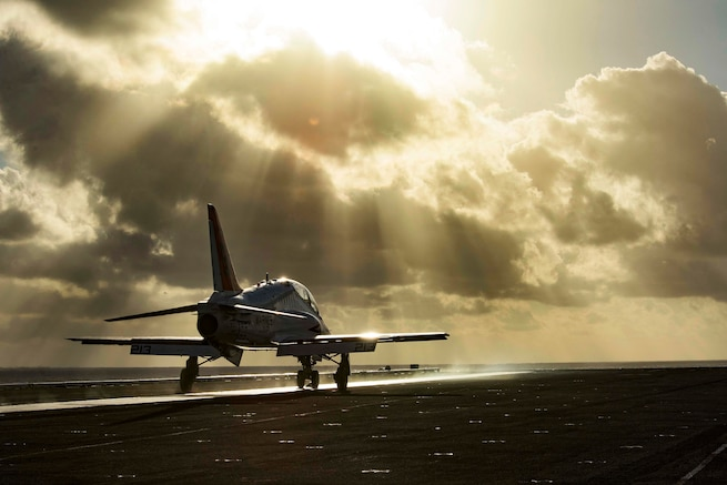A T-45C Goshawk takes off from the flight deck of the aircraft carrier USS Dwight D. Eisenhower in the Atlantic Ocean, Feb. 3, 2015. The aircraft is assigned to Training Air Wing 2. Navy photo by Petty Officer 3rd Class J. Alexander Delgado