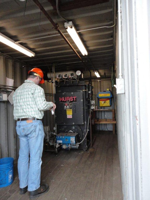 An EEAP auditor performs an evaluation of a steam boiler at Portland Moorings.The evaluation provides the planning needed to identify federally mandated energy reduction opportunities and propose energy related projects in order to meet the energy and water intensity reduction requirements.