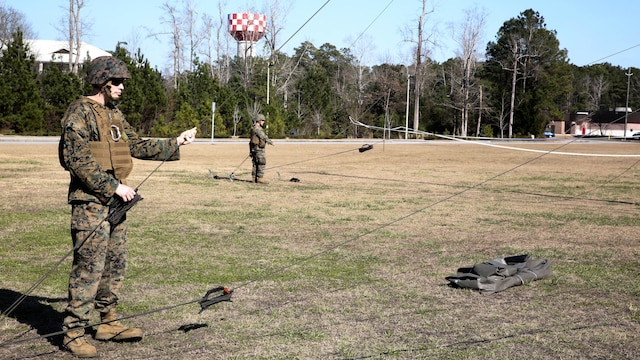 Sgt. Gordon Rodgers, a field radio operator with Headquarters Company, Combat Logistics Regiment 25, raises an antenna during a command post exercise at Camp Lejeune, N.C., Feb. 2, 2016. The mission of 2nd Marine Logistics Group is to provide general support combat logistics to all forces operating in the II Marine Expeditionary Force battlespace.