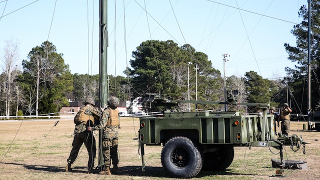 Marines with Headquarters Company, Combat Logistics Regiment 25, conduct a maintenance check on an antenna during a command post exercise at Camp Lejeune, N.C., Feb. 2, 2016. The CPX was held as a pre-cursor to an II Marine Expeditionary Force-wide CPX.