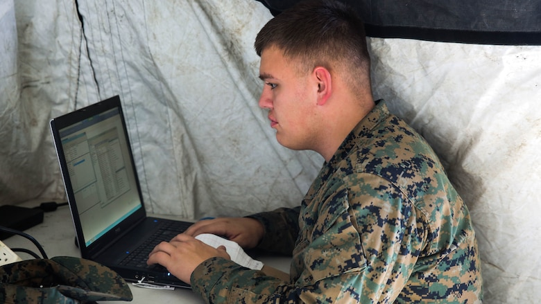 Pfc. Alec Rivera, a cyber-network specialist with Headquarters Company, Combat Logistics Regiment 25, works on a computer during a command post exercise at Camp Lejeune, N.C., Feb. 2, 2016. As a cyber-network specialist, Rivera is responsible for configuring and maintaining connectivity across networks.