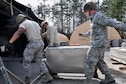 Force Support Silver Flag students at Dobbins Air Reserve Base work together to transport a field sanitation unit into the single palletized expeditionary kitchen Jan. 25, 2016 at Dobbins Air Reserve Base, Ga. The SPEK is where food is prepared and served. (Photo by U.S. Air Force Senior Airman Lauren Douglas)