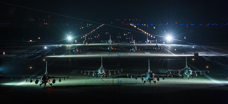 Twenty F-16s from the 8th Fighter Wing line up for an elephant walk early in the morning on Feb. 3, 2016 at Kunsan Air Base, Republic of Korea. The elephant walk was designed to test the 8 FW's ability to launch aircraft at a moment's notice. (U.S Air Force photo by Staff Sgt. Nick Wilson/Released)