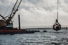 WARRENTON, Oregon — A crane relocates a large jetty stone, Jan. 22, 2016. The U.S. Army Corps of Engineers, the Columbia River Estuary Study Taskforce and other state and local partners are working together to create fish passages in the Trestle Bay jetty. (Photo by Jeffrey Henon. Courtesy U.S. Army Corps of Engineers)