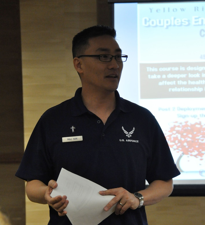 Chaplain (Maj.) Joshua Kim welcomes 17 couples to the inaugural Couples Enrichment Program class Jan. 30, 2015, during a Yellow Ribbon Reintegration Program training weekend in Denver. Kim, a reservist with the 459th Air Refueling Wing at Joint Base Andrews, Maryland, adapted the curriculum from a civilian course to help Airmen and their partners take a deeper look into important dynamics that affect the health of relationships. (U.S. Air Force photo by Master Sgt. Megan Crusher)