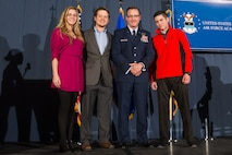 Brig. Gen. Kevin Lamberth, the vice superintendent of the U.S. Air Force Academy, stands on stage with daughter-in-law Katelyn (left) and sons Austin and Nathan Lambert (right) during his promotion ceremony, Jan. 29, 2016 at the Falcon Club.  Lamberth was officially promoted to brigadier general Jan.1, 2016, but scheduled the ceremony later in the month so relatives and friends could attend. (U.S. Air Force photo/Liz Copan)