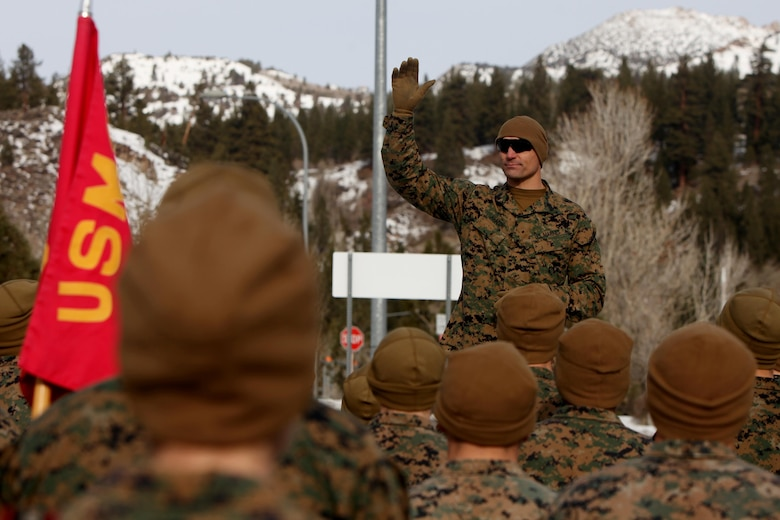 Master Sgt. Donald Johnson greets 2nd Low Altitude Air Defense Battalion Marines during cold weather training at Marine Corps Mountain Warfare Training Center, Calif., Jan. 21, 2016. The cold weather training done in the Sierra Mountains is a warm-up to Exercise Cold Response 1-16 in Norway. Nearly 80 Marines with 2nd LAAD Bn. participated in the two-weeklong exercise that taught basic mobility in snow, defensive and offensive tactics as well as basic cold weather and high altitude conditions training. Johnson is the operations chief with 2nd LAAD Bn.