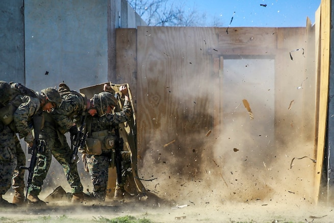 Marines shield themselves from a detonated explosive charge during an urban training course on Marine Corps Base Camp Pendleton, Calif., Jan. 29, 2016. During the course, Marines learned about four different types of charges. Marine Corps photo by Pvt. Robert Bliss