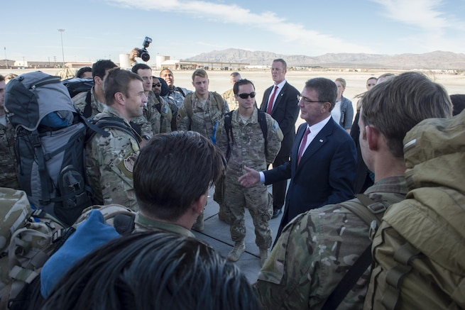 Defense Secretary Ash Carter greets troops returning from a deployment to Djibouti while visiting Nellis Air Force Base, Nev., Feb. 4, 2016. Carter visited the base to tour facilities and discuss future budgets. DoD photo by Navy Petty Officer 1st Class Tim D. Godbee