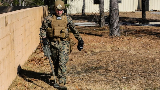 Staff Sgt. Chaz Carter, an Explosive Ordnance Disposal technician with EOD Company, 8th Engineer Support Battalion, searches the area during an improvised explosive device access training exercise aboard Camp Lejeune, N.C., Jan. 29, 2016. During the exercise, evaluators assessed Marines on safely locating and disposing of an IED while suppressing the full capabilities of the threat.