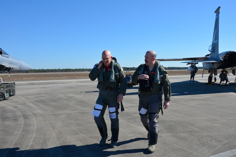 From the 142nd Fighter Wing, Portland Oregon, Col. Paul Fitzgerald, wing commander and F-15 Eagle pilot, (left) walks with fellow pilot, Maj. Vic Knill, 123rd Fighter Squadron, following a Combat Archer sortie at Tyndall Air Force Base Jan. 29. Combat Archer is a two-week weapon systems evaluation program where participants load, fly and shoot live missiles and subsequently evaluate the entire process to validate whether the weapon performs according to established specifications. (Air Force Photo Released/Mary McHale)