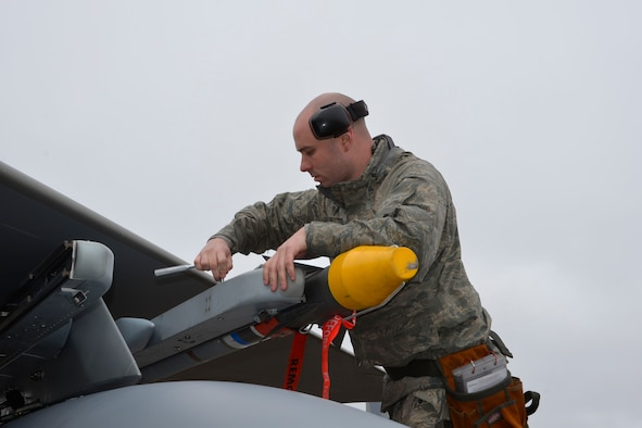 From the 142nd Fighter Wing, Portland, Oregon, Staff Sgt. Brian Boatman, 142nd Maintenance Group weapons loader, tightens a missile to the rail of an F-15 Eagle Jan. 28 during a deployment to Combat Archer, a two-week weapon systems evaluation program at Tyndall Air Force Base. During the program, participants load, fly and shoot live missiles and subsequently evaluate the entire process to validate whether the weapon performs according to established specifications. (Air Force Photo Released/Mary McHale)