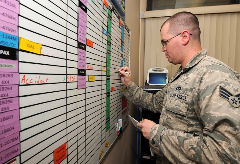 Senior Airman John Spencer, 30th Logistics Readiness Squadron vehicle controller, updates the dispatch board in the vehicle operations control center, Jan. 21, 2016, Vandenberg Air Force Base, Calif. It is not uncommon for the 30th LRS fleet of UDI vehicles to be exhausted during launches at Vandenberg. (U.S. Air Force Photo by Michael Peterson/Released)