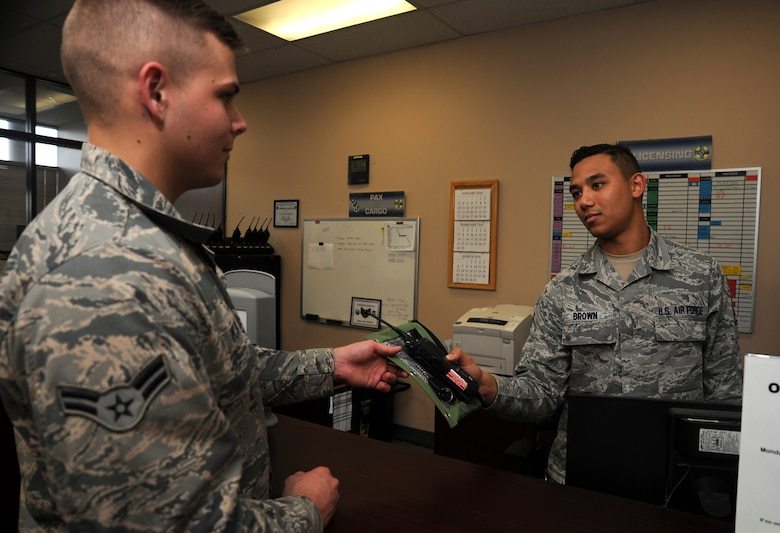 Airman 1st Class David Kucko, 30th Logistics Readiness Squadron vehicle operator picks up keys from Airman 1st Class Pierre Brown, 30th LRS vehicle controller, for a pre-inspection of a U-Drive-It vehicle, Jan. 21, 2016, Vandenberg Air Force Base, Calif. It is not uncommon for the 30th LRS fleet of UDI vehicles to be exhausted during launches at Vandenberg. (U.S. Air Force Photo by Michael Peterson/Released)