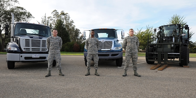 Airman 1st Class David Kucko, Airman Marcus Travis and Airman 1st Class Batson Wilson, 30th Logistics Readiness vehicle operators showcase some of the larger fleet vehicles in their yard, Jan. 21, 2016, Vandenberg Air Force Base, Calif. The 30th LRS vehicle operations works as the control center for government vehicles not assigned to specific units, a fleet of 61 vehicles that includes everything from everyday sedans, trucks and buses to more specialized equipment like 10-ton tractors and all-terrain forklifts. (U.S. Air Force Photo by Michael Peterson/Released)