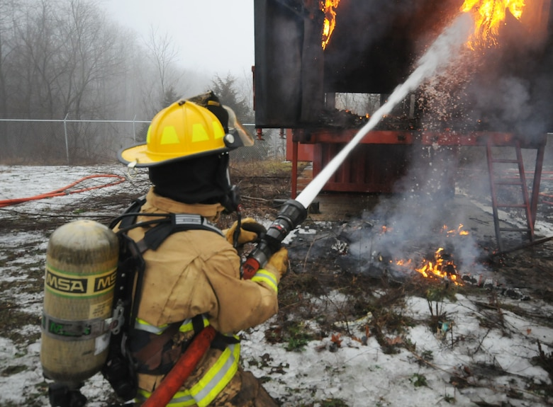 110th Attack Wing, Civil Engineering Squadron, Firefighters conduct Flashover training Saturday, January, 9, 2016, Thornapple Township Fire Station, Middleville, Mich.  In total fifteen firefighters participated in the flashover training, flashovers normally occur at 930 to 1100 degrees Fahrenheit, gases form at the ceiling of a structure, and suddenly ignite causing the entire ceiling to be on fire.  The 110th Fire Department is working closely with our local communities to increase hands on training and enrich our local partnerships.  (U.S. Air Force photo by Tech. Sgt. Timothy Diephouse/released)