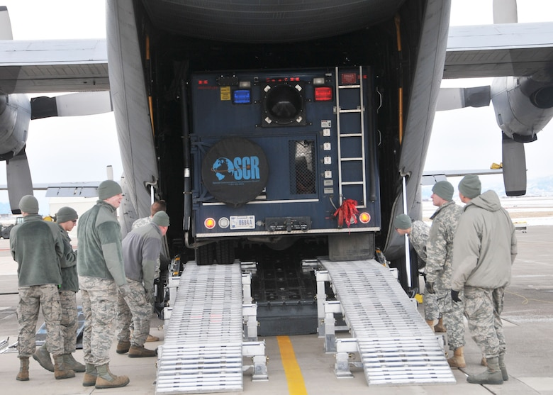 Members of the 83rd Civil Support Team and 120th Airlift Wing of the Montana National Guard load a CST operations vehicle onto a C-130 Hercules Jan. 21, 2016. The guardsmen were exercising the loading of CST equipment and vehicles should they have to transport the equipment in an actual state or federal emergency. (U.S. Air National Guard photo by Senior Master Sgt. Eric Peterson/Released)