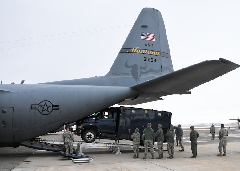 Members of the 83rd Civil Support Team and 120th Airlift Wing of the Montana National Guard load a CST operations vehicle onto a C-130 Hercules Jan. 21, 2016. The guardsmen were exercising the loading of CST equipment and vehicles in the event they have to transport the equipment in an actual state or federal emergency. (U.S. Air National Guard photo by Senior Master Sgt. Eric Peterson/Released)