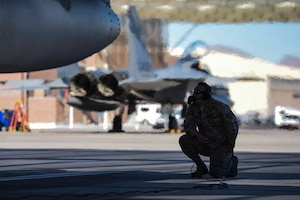U.S. Air Force Staff Sgt. Tomas Medina, 144th Maintenance Squadron crew chief, conducts a preflight check on an F-15C Eagle as part of Red Flag 16-1 at the Nellis Air Force Base, Nev. flight line Feb. 2, 2016. Red Flag is a realistic combat training exercise which involves air, space and cyber forces from the U.S. and its allies. (U.S. Air National Guard photo by Senior Airman Klynne Pearl Serrano)