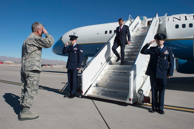 Air Force Maj. Gen. Jay B. Silveria, commander, U.S. Air Force Warfare Center, greets Defense Secretary Ash Carter as he arrives on Nellis Air Force Base, Nev., Feb. 4, 2016. Carter visited the base to tour facilities and discuss future budgets. DoD photo by Navy Petty Officer 1st Class Tim D. Godbee