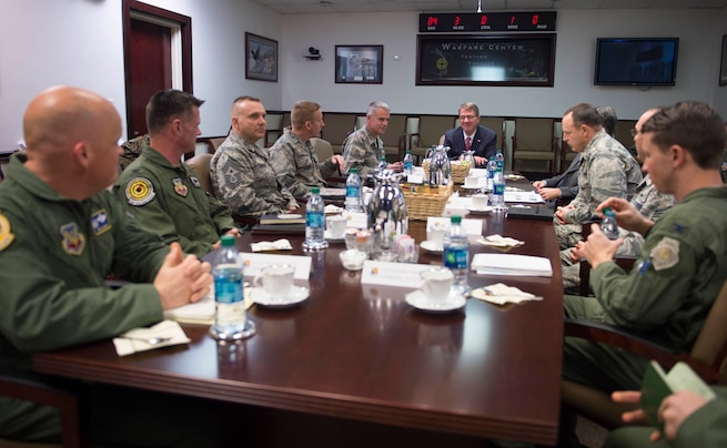 Defense Secretary Ash Carter, center back, receives a briefing on the operations of the Air Force Warfare Center at Nellis Air Force Base, Nev., Feb. 4, 2016. DoD photo by Navy Petty Officer 1st Class Tim D. Godbee