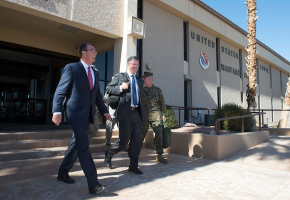 Defense Secretary Ash Carter, left, departs the Air Force Warfare Center on Nellis Air Force Base, Nev., Feb. 4, 2016. DoD photo by Navy Petty Officer 1st Class Tim D. Godbee