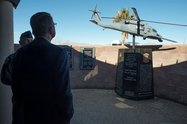 Defense Secretary Ash Carter observes a memorial for fallen airmen who were assigned to the 66th Rescue Squadron on Nellis Air Force Base, Nev., Feb. 4, 2016. DoD photo by Navy Petty Officer 1st Class Tim D. Godbee