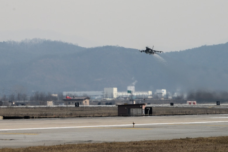 An F-16 Fighting Falcon takes off on the new runway at Osan Air Base, Republic of Korea, Jan. 22, 2016. The Army Corps of Engineers, 51st Civil Engineer and Operation Support Squadron completed the five-year project to construct the new runway in January 2016. (U.S. Air Force photo by Airman 1st Class Dillian Bamman/Released)