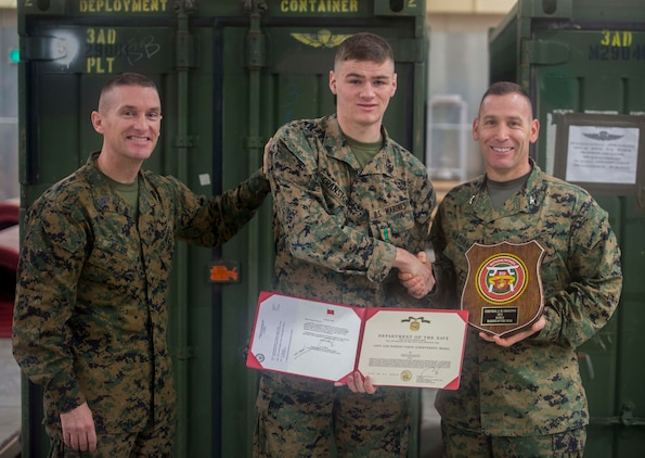 Cpl. John M. Cranston, middle, poses for a photo with Col. David Nathanson, right, and Sgt. Maj. Michael Miller, left, after receiving the 3rd Marine Logistics Group Marine of the Year award at Camp Foster, Okinawa, Japan, Feb. 5, 2016. Cranston was awarded Marine of the year for his devotion to his job and his commitment to being the best Marine he could be. Cranston from, Canby, Oregon, is an administrative specialist with 3rd Transport Support Battalion, Combat Logistics Regiment 3, 3rd MLG, III Marine Expeditionary Force. Nathanson from Jackson, New Jersey, is the commanding officer for CLR 3. Miller from French Camp, California, is the Sergeant Major of CLR 3. (U.S. Marine Corps Photo by Cpl. Devon Tindle/Released)