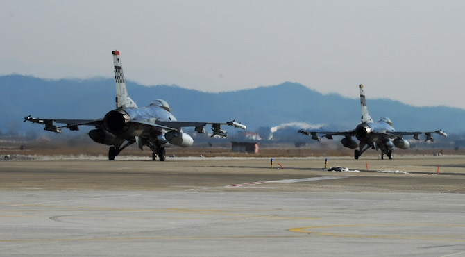 F-16 Fighting Falcons taxi before takeoff on the new runway at Osan Air Base, Republic of Korea, Jan. 22, 2016. The 51st Operations Support Squadron and 36th Fighter Squadron use the new runway to execute training and combat missions for the Republic of Korea. (U.S. Air Force photo by Airman 1st Class Dillian Bamman/Released)