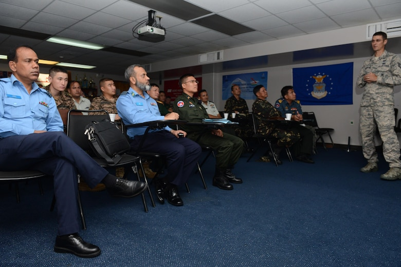 A mission planning and development discussion is held for military representatives during the Pacific Defender Security Forces Subject Matter Expert Exchange 16-1 Feb. 3, 2016, at Andersen Air Force Base, Guam. Pacific Defender 16-1 was a five-day event that enhanced strong personal relationships and cooperation with selected Indo-Asia-Pacific nations. (U.S. Air Force photo/Airman 1st Class Arielle Vasquez)