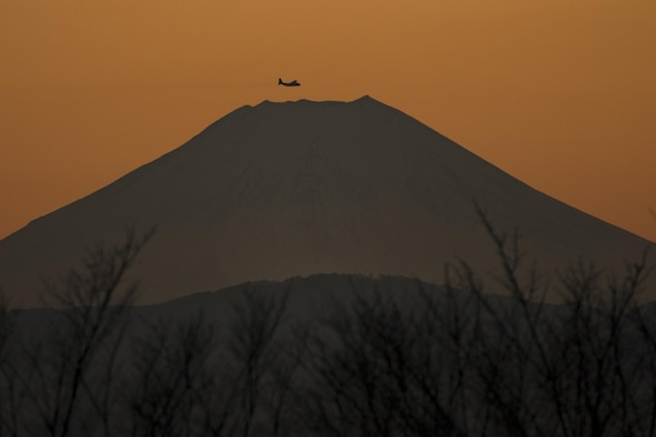 A C-130 Hercules assigned to the 36th Airlift Squadron flies near Mount Fuji, Japan, during a routine sortie Jan. 26, 2016, at Yokota Air Base, Japan. The 36th AS regularly conducts training missions to remain proficient in the necessary skills to support any contingency. (U.S. Air Force photo/Osakabe Yasuo)