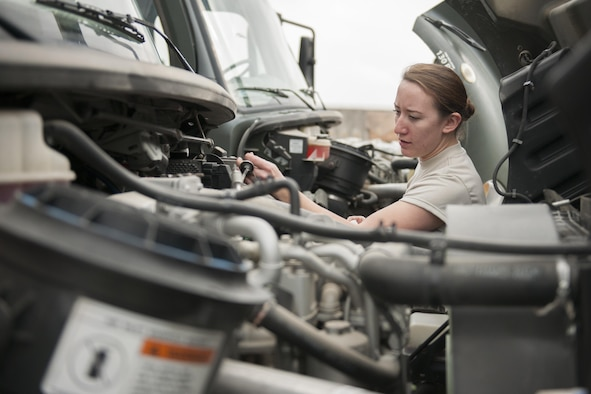 Senior Airman Rebecca Delay, a 421st Expeditionary Aircraft Maintenance Squadron Support Section support technician, checks fluid levels on a deicing vehicle at Bagram Airfield, Afghanistan, Jan. 29, 2016. The support section accounts for equipment, stores hazardous materials, maintains and inspects vehicles and ensures tools are in working condition for optimal maintenance production. (U.S. Air Force photo/Tech. Sgt. Robert Cloys)