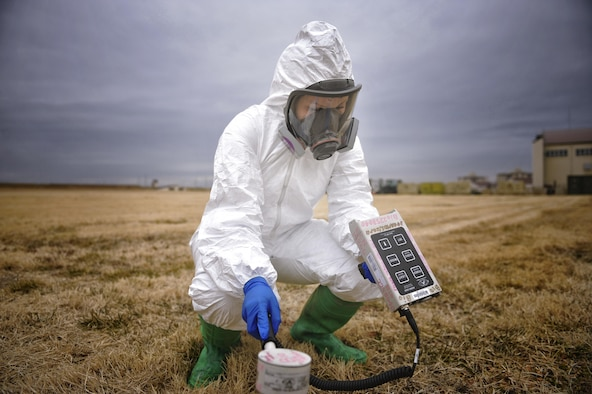 Airman Natalie Gaston, a 374th Medical Support Squadron bioenvironmental technician, simulates using an ADM 300, an instrument that measures radiation in the air, at Yokota Air Base, Japan, Feb. 1, 2016. Bioenvironmental engineering first responders use an ADM 300 to protect them from possible contamination while taking samples. (U.S. Air Force photo/Airman 1st Class Delano Scott)