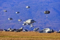 Army paratroopers land onto Juliet drop zone during airborne operations training in Pordenone, Italy, Jan. 21, 2016. Army photo by Paolo Bovo