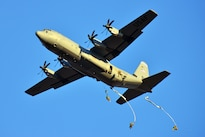 Army paratroopers exit an Air Force C-130 Hercules aircraft during airborne operations training over Juliet drop zone in Pordenone, Italy, Jan. 21, 2016. Army photo by Paolo Bovo