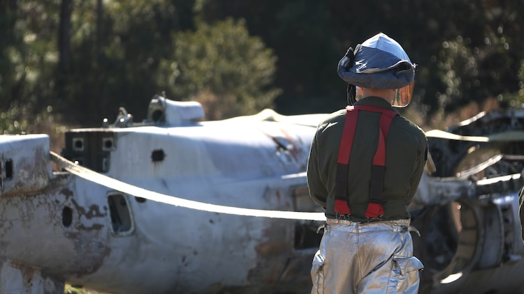 Lance Cpl. Jacob Davis ties down an aircraft during an aircraft recovery training exercise at Marine Corps Auxiliary Landing Field Bogue, N.C., Feb. 2, 2016. Aircraft rescue and firefighting Marines, heavy equipment operators, bulk fuels specialists,  motor transportation Marines and combat engineers with Marine Wing Support Squadron 274 worked hand-in-hand to retrieve a simulated downed aircraft. They were given a scenario and were tasked to provide a security perimeter around the aircraft while securing and transporting the aircraft in a safe and effective manner. The ability to retrieve aircraft without the aid of outside resources increases the unit's effectiveness and their expeditionary capabilities. Davis is a aircraft rescue firefighter with MWSS-274.