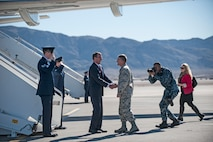 Defense Secretary Ash Carter is greeted by Maj. Gen. Jay Silveria, the U.S. Air Force Warfare Center commander, upon his arrival to Nellis Air Force Base, Nev., Feb. 4, 2016. Carter's visit consisted of briefings and meetings with Airmen focused on readiness; and comes a week before President Barack Obama will release his administration's 2017 defense budget. (U.S. Air Force photo/Senior Airman Joshua Kleinholz)
