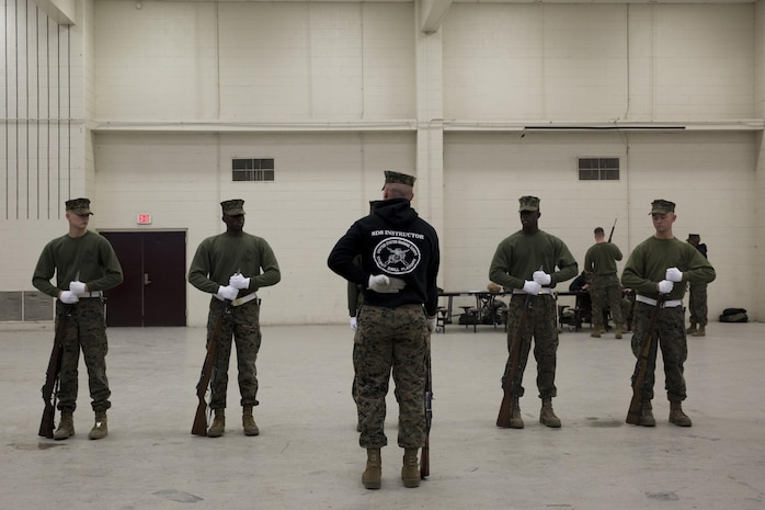 Lance Cpl. Jarris Wade, a Silent Drill School instructor, conducts baseline drill sequence training, called landing party manual, with students at Joint Base Anacostia, Washington, D.C., Jan. 8, 2016. Each year from November to March the Silent Drill Platoon conducts Silent Drill School to hand-select new Marines for the upcoming parade season.  The selection process is conducted by Marines from previous years to identify Marines who will represent, on the parade deck, the professionalism associated with the Marine Corps. (Official Marine Corps photos by Cpl. Chi Nguyen/Released)