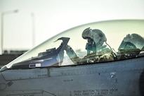 Air Force Lt. Col. Thomas Wolfe, deputy commander of the 455th Expeditionary Operations Group, performs preflight checks on an F-16 Fighting Falcon at Bagram Airfield, Afghanistan, Feb. 1, 2016.