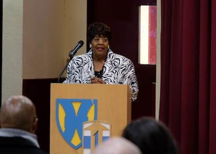 """Myrtis Womack Johnson, the founder of Save Our Graves Foundation, speaks during the 7th Mission Support Command's African American/Black History Month observance Friday February 5, 2016 on Daenner Kaserne in Kaiserslautern, Germany. This year's theme is """"Hallowed Grounds: Sites of African American Memories."""" (Photo by Sgt. 1st Class Matthew Chlosta, 7th Mission Support Command Public Affairs)"""