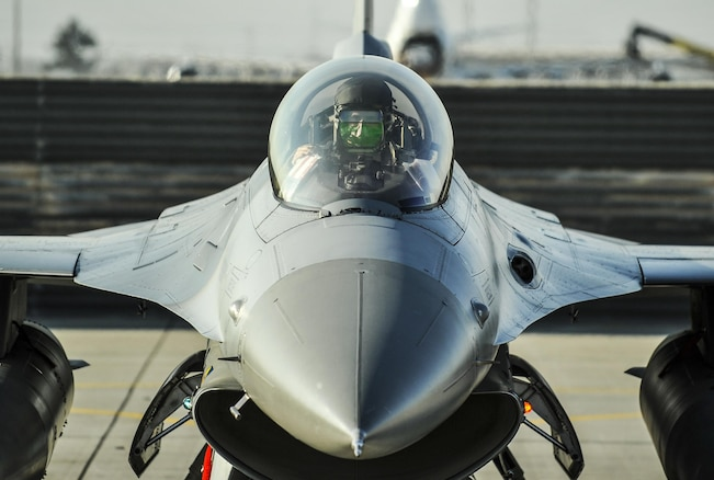 Air Force Lt. Col. Thomas Wolfe performs preflight checks on an F-16 Fighting Falcon aircraft on Bagram Airfield, Afghanistan, Feb. 1, 2016. Wolfe is deputy commander of the 455th Expeditionary Operations Group. Air Force photo by Tech. Sgt. Nicholas Rau